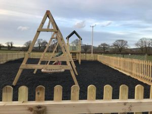 The Dorset Hideaway adventure playground with chippings
